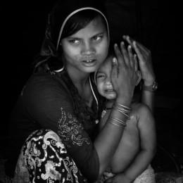 Bangladesh, Cox's Bazaar. A Rohingya refugee woman holds her young child . Over 650,000 Rohingya have crossed the border to Bangladesh since August last year, fleeing the violence.
