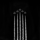 Members of the Frecce Tri Colori aerobatic display squad perform an aerial display in Dubai, United Arab Emirates.