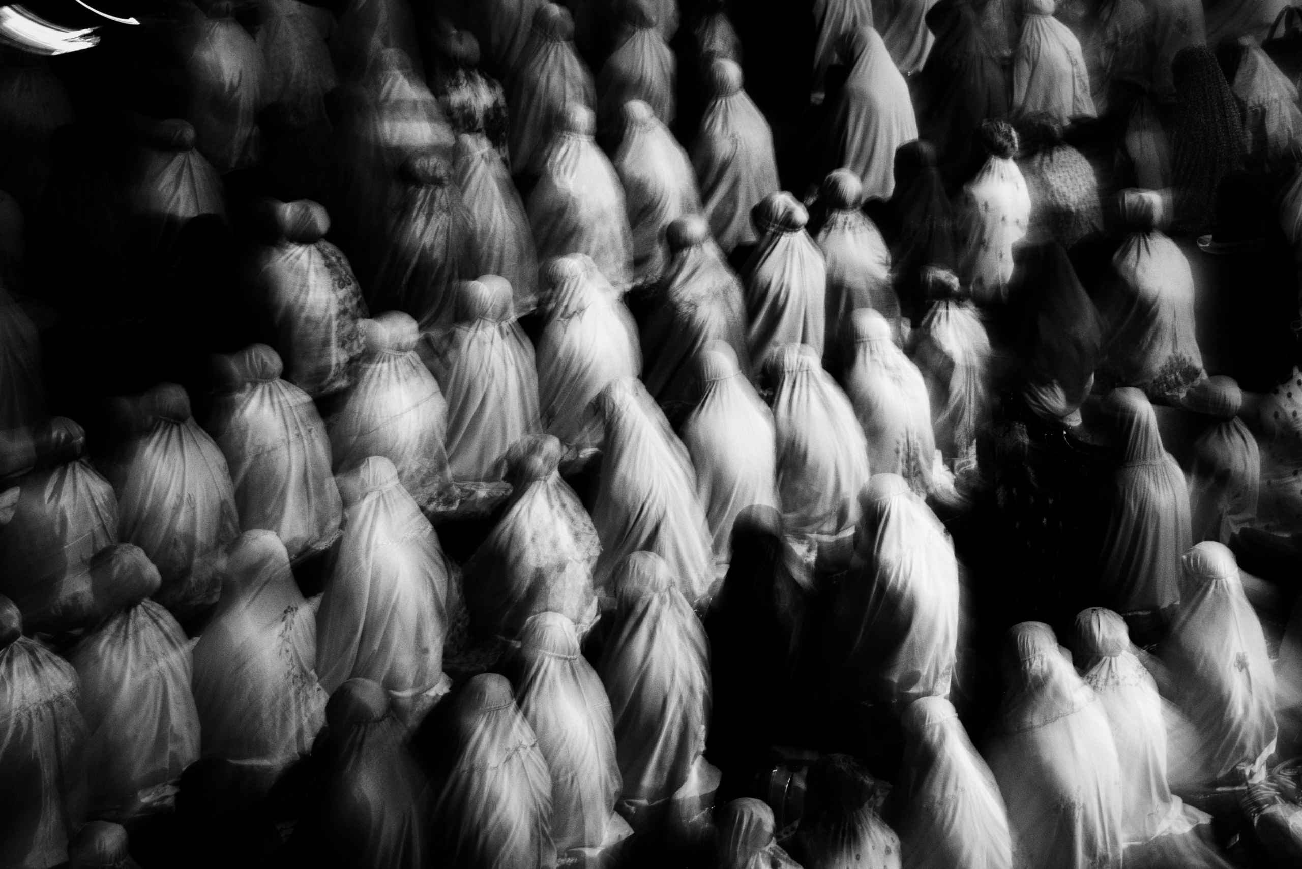 Indonesian Muslims women perform an evening prayer. Jakarta, Indonesia.