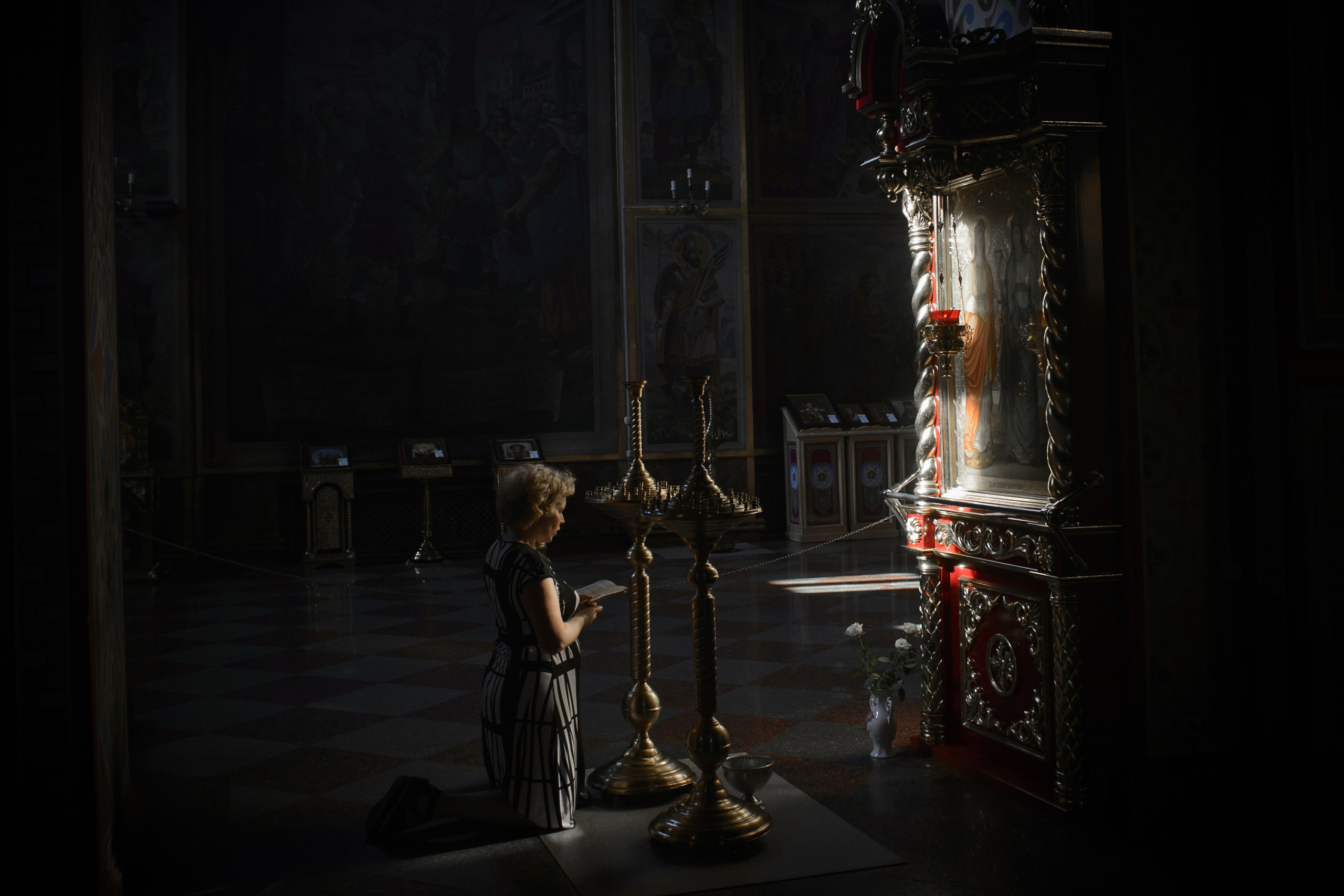 Kiev-Ukraine. a woman pray in an Orthodox church for his family who could not leave the area affected by the conflict. The fight between pro-Ukrainian troops and pro-Russian separatists is continuing in the Donbas region of eastern Ukraine despite the recent Minsk ceasefire agreements.