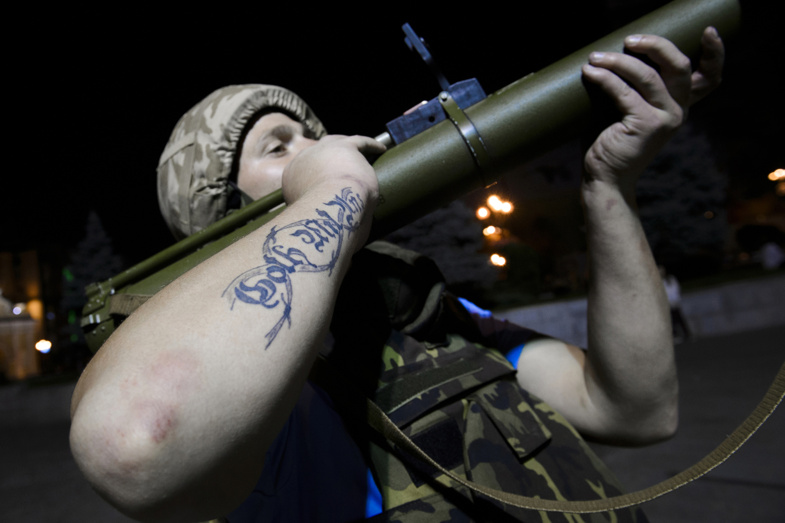 Kiev-Ukraine. A nationalist militant explains handling a rocket launcher. The fight between pro-Ukrainian troops and pro-Russian separatists is continuing in the Donbas region of eastern Ukraine despite the recent Minsk ceasefire agreements.