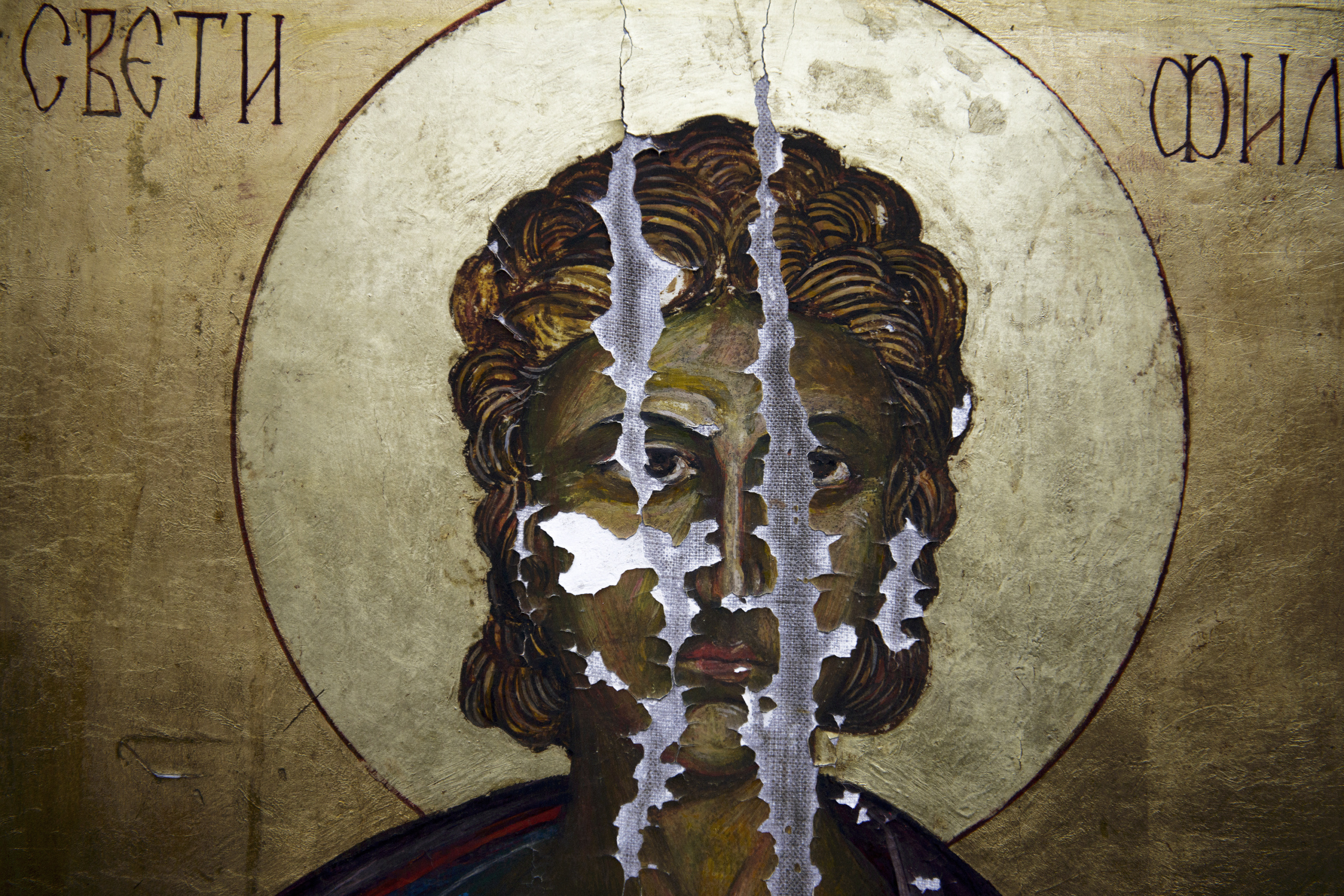 A picture taken on May 2014,shows a damaged icon in a monastery at Skopje Macedonia.