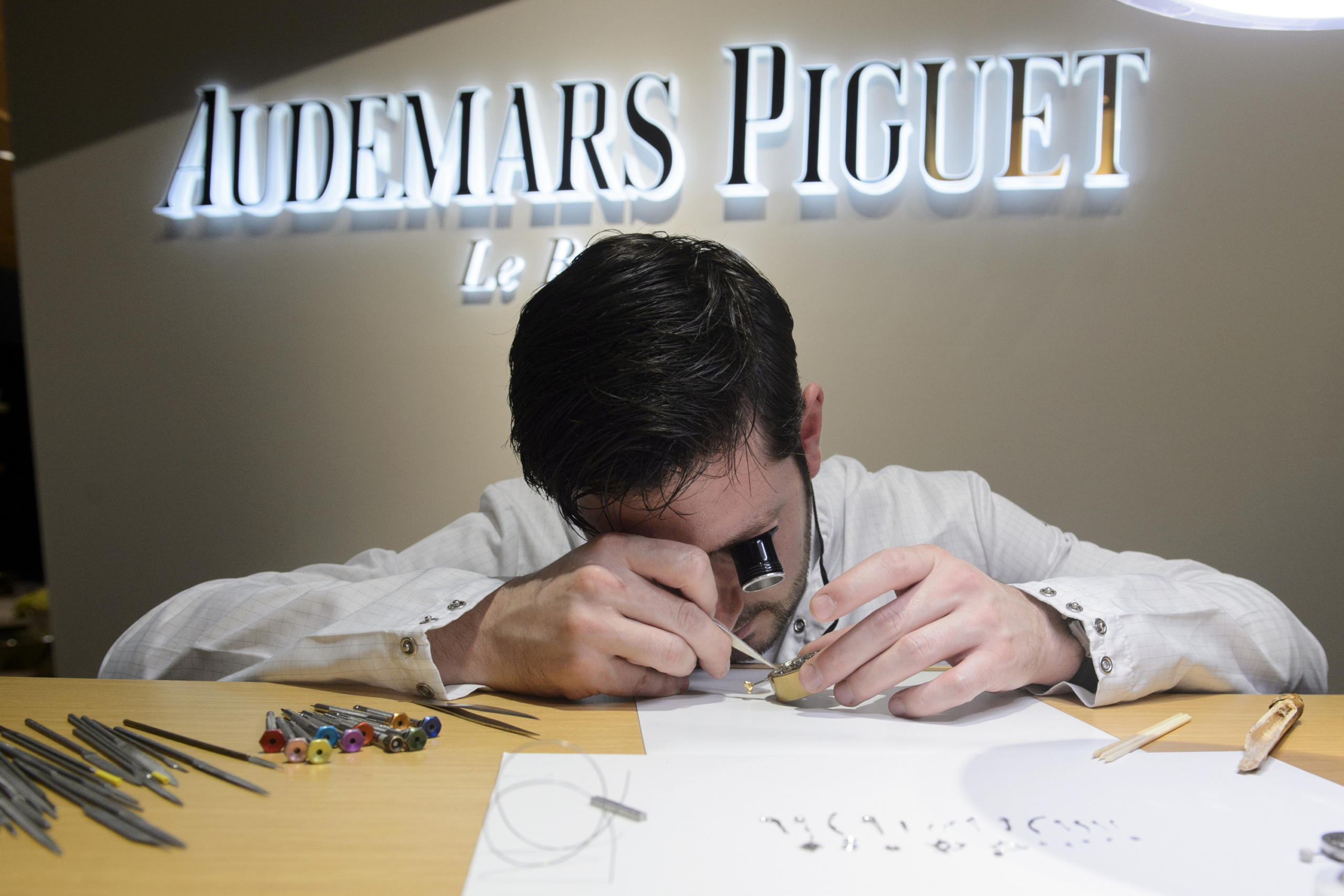 An employe of Swiss watchmaker Audemars Piguet checks a wristwatch during the opening day of the 'Salon International de la Haute Horlogerie' (SIHH), a professional fair in fine watchmaking, on January 18, 2016. / AFP / Richard Juilliart (Photo credit should read RICHARD JUILLIART/AFP/Getty Images)