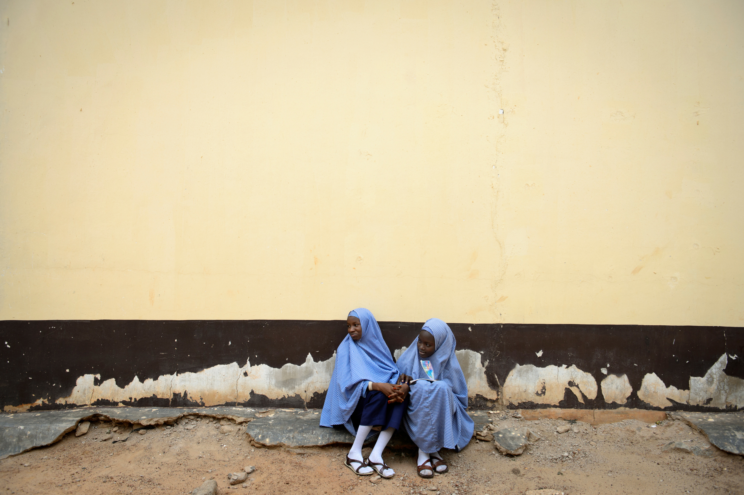 NIGERIA,Kaduna.Two girls in an interdenominational school of Kaduna.Nearly 4,000 people have died in Nigeria due to the violent conflict over the past decade.The economic and ethnic conflict in the northern states has a religious dimension. It is only with true governance that these conflicting differences could be managed. As elsewhere in Nigeria, residents accuse both local and state government officials for promoting identity-based divisions to advance their own political agendas.