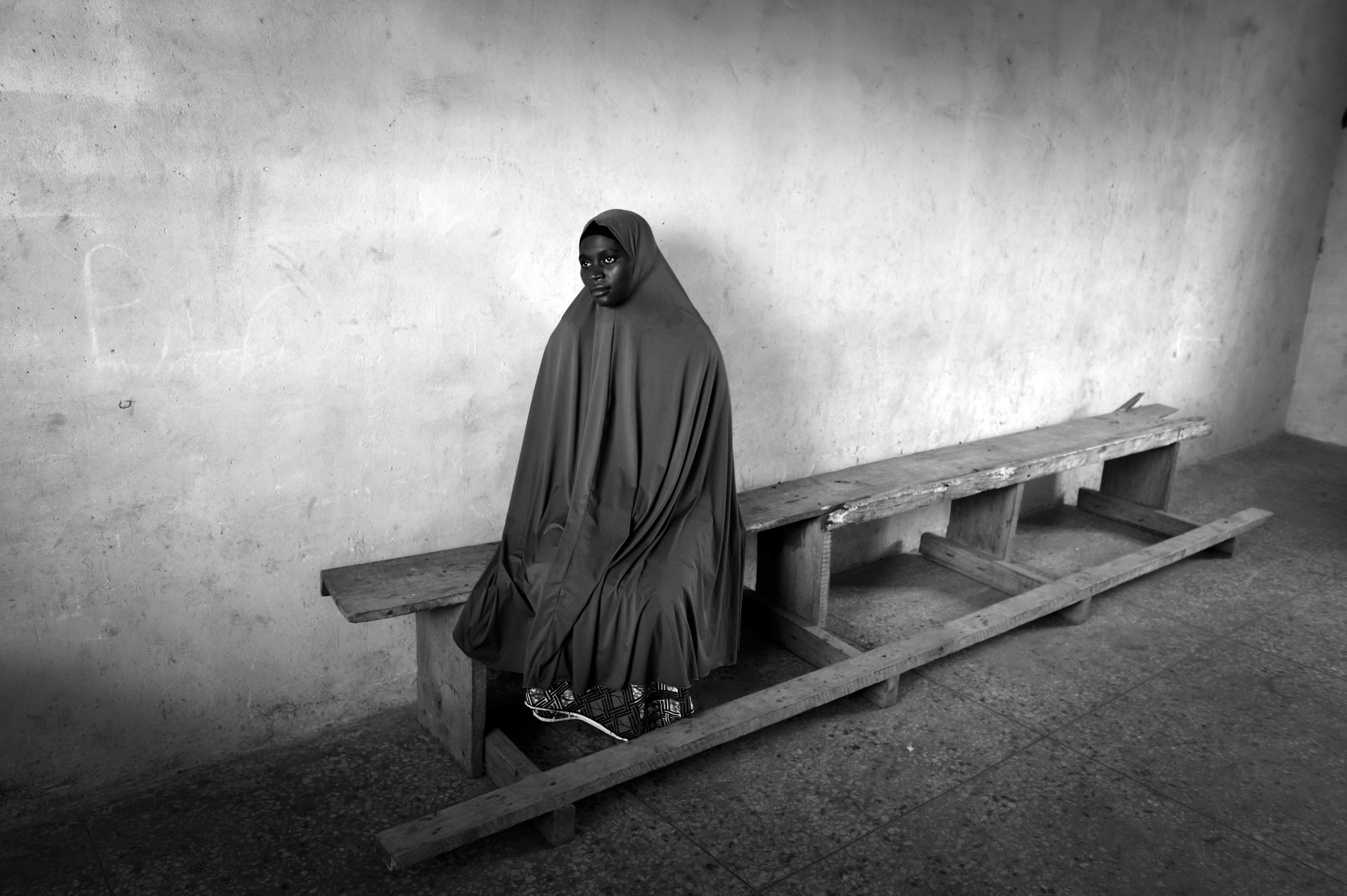 NIGERIA,Kaduna.A Muslim woman waits that her husband picks her up having taken lessons in a Koranic school in a Muslim district of Kaduna.Nearly 4,000 people have died in Nigeria due to the violent conflict over the past decade.The economic and ethnic conflict in the northern states has a religious dimension. It is only with true governance that these conflicting differences could be managed. As elsewhere in Nigeria, residents accuse both local and state government officials for promoting identity-based divisions to advance their own political agendas.