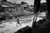 NIGERIA,Kaduna.A young boy runs in front of a church destroyed during inter-religious confrontations in a Muslim district of Kaduna.Nearly 4,000 people have died in Nigeria due to the violent conflict over the past decade.The economic and ethnic conflict in the northern states has a religious dimension. It is only with true governance that these conflicting differences could be managed. As elsewhere in Nigeria, residents accuse both local and state government officials for promoting identity-based divisions to advance their own political agendas.