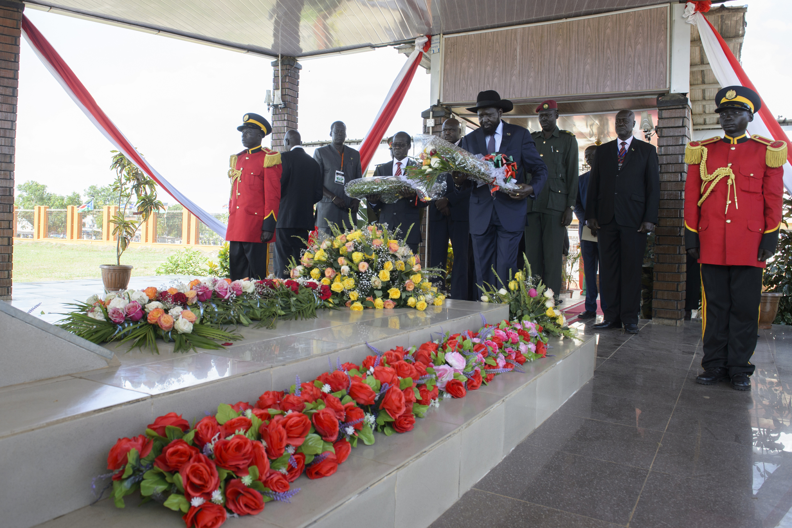 — SOUTH SUDAN Juba, South Sudan. South Sudan President Salva Kiir stand at attention at the grave of Dr. John Garang at Dr. John Garang Memorial in Juba. On 9th of July 2011 a new country will be born in Africa. The Republic of South Sudan will be the 54th African state and the 193rd nation in the world. But South Sudan is a very poor country, despite its large oil reserves, which account for 98 percent of its income. South Sudan's society is deeply divided along tribal lines. The main clan is the Dinka, a pastoral semi-nomadic population. Violence is endemic to the region, often as a consequences of cattle ownership issues. But violence is also very much fed by the uncountable number of weapons circulating in the country, the heavy legacy of a 30 year long civil war against North Sudan.