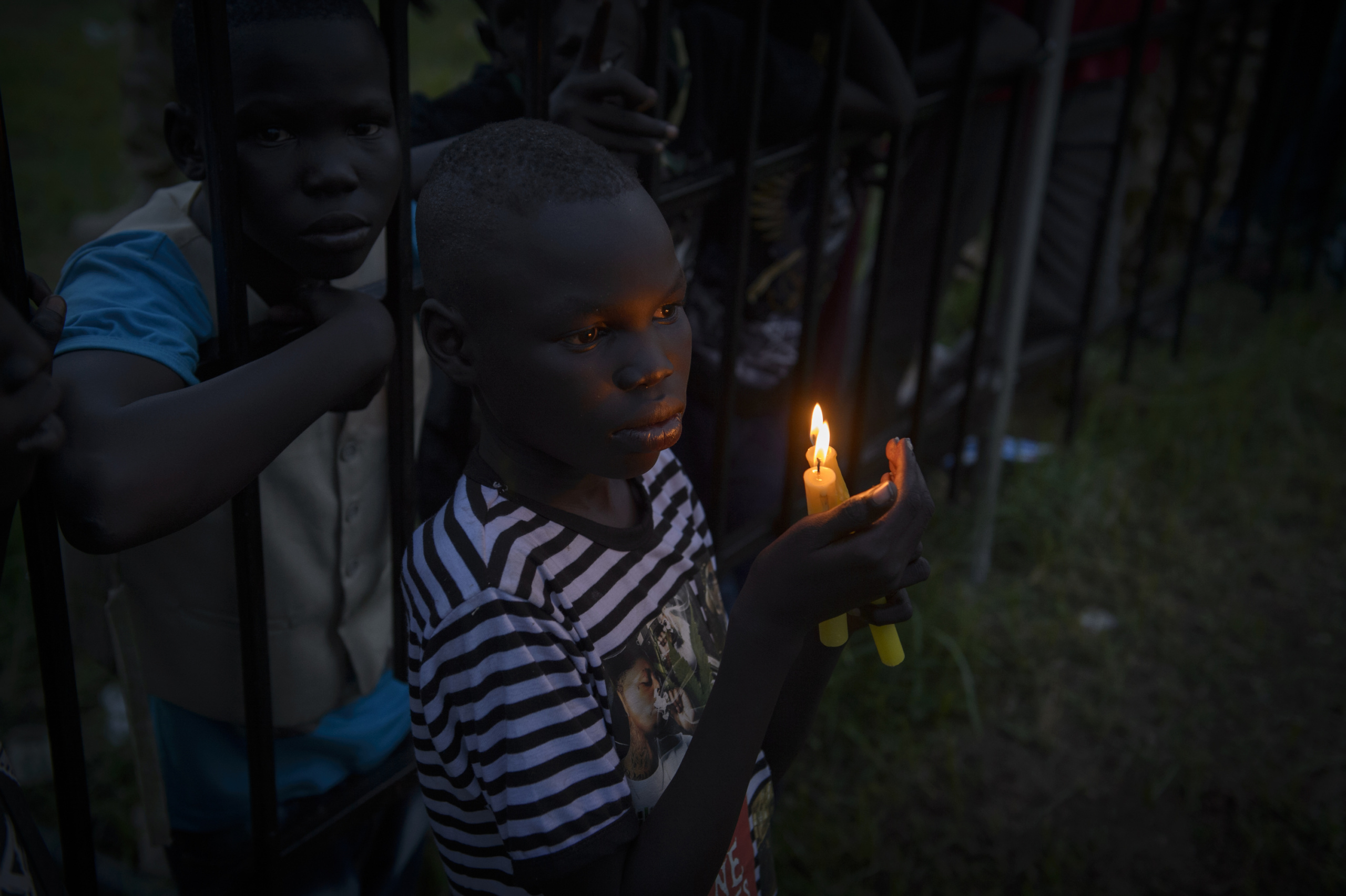 — SOUTH SUDAN Juba, South Sudan. South Sudanese boy hold candles as the clock ticks over to midnight to commemorate the day that South Sudan will officially declare independence from the north. On 9th of July 2011 a new country will be born in Africa. The Republic of South Sudan will be the 54th African state and the 193rd nation in the world. But South Sudan is a very poor country, despite its large oil reserves, which account for 98 percent of its income. South Sudan's society is deeply divided along tribal lines. The main clan is the Dinka, a pastoral semi-nomadic population. Violence is endemic to the region, often as a consequences of cattle ownership issues. But violence is also very much fed by the uncountable number of weapons circulating in the country, the heavy legacy of a 30 year long civil war against North Sudan.
