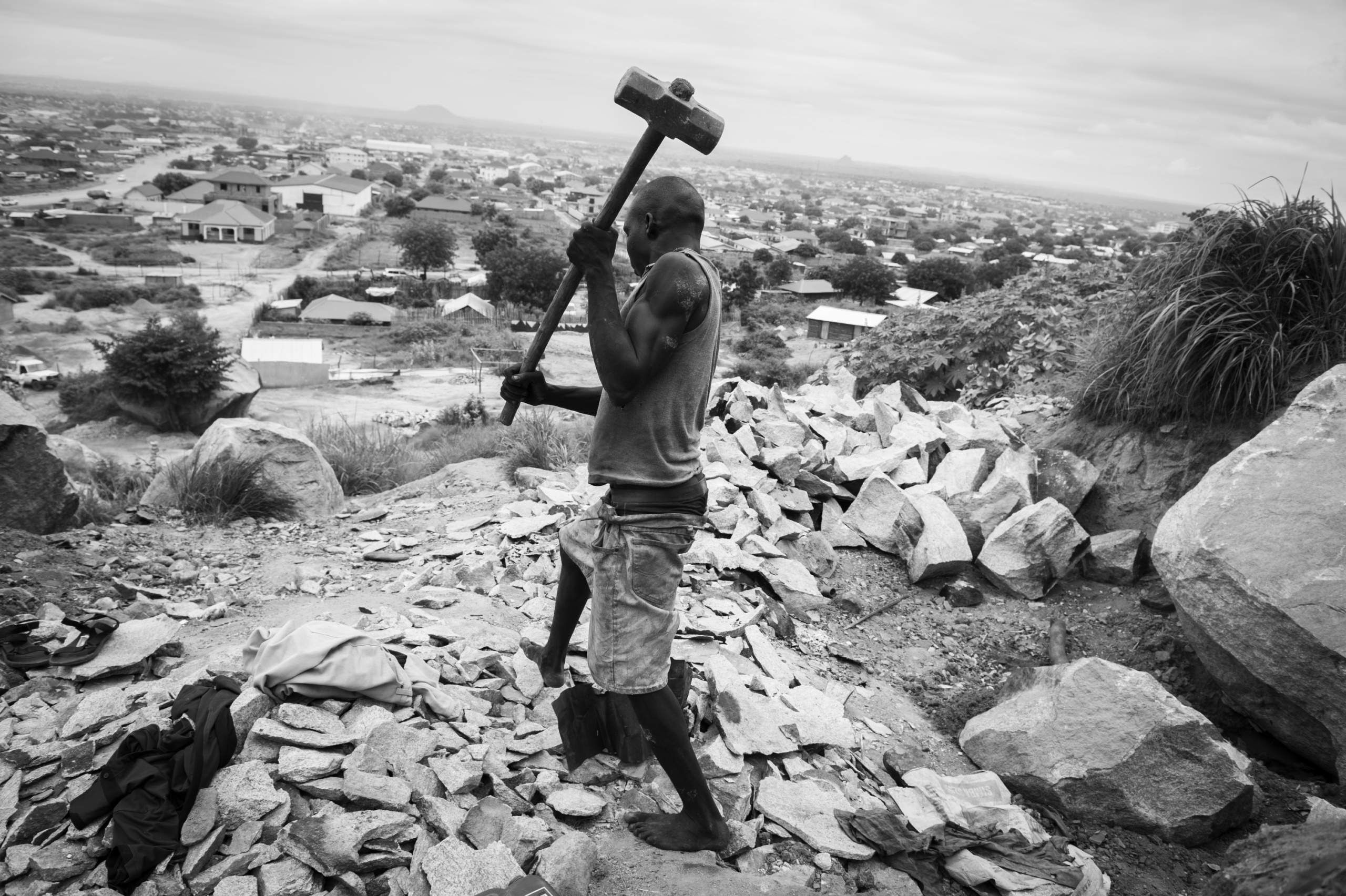 — SOUTH SUDAN Juba, South Sudan. A man working in a stone quarry at Juba. On 9th of July 2011 a new country will be born in Africa. The Republic of South Sudan will be the 54th African state and the 193rd nation in the world. But South Sudan is a very poor country, despite its large oil reserves, which account for 98 percent of its income. South Sudan's society is deeply divided along tribal lines. The main clan is the Dinka, a pastoral semi-nomadic population. Violence is endemic to the region, often as a consequences of cattle ownership issues. But violence is also very much fed by the uncountable number of weapons circulating in the country, the heavy legacy of a 30 year long civil war against North Sudan.