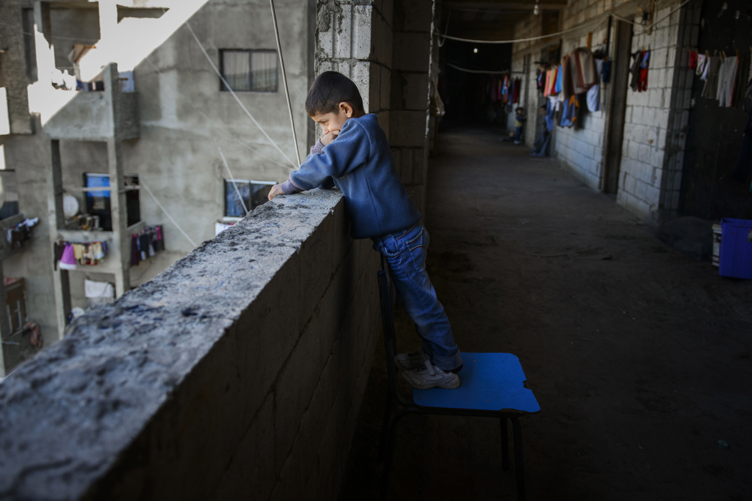 "Saida-Lebanon. Young child on an abandoned construction site occupied by Syrian refugees. This building, referred to as a ""collective shelter"", is owned by the Islamic University and financed by a Kuwaiti association. About 150 families live within it, all from the Syrian Daraa region. The refugees  try to survive through public subsidies and underpaid labor. the Lebanese government will not allow traditional refugee camps in Lebanon, refugees are finding unusual places to live across the country, including unfinished homes, abandoned shopping malls and schools ......."