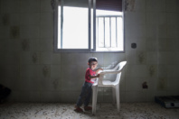 Saida-Lebanon. Child in an abandoned construction site occupied by Syrian refugees.  The refugees try to survive through public subsidies and underpaid labor. the Lebanese government will not allow traditional refugee camps in Lebanon, refugees are finding unusual places to live across the country, including unfinished homes, abandoned shopping malls and schools …….