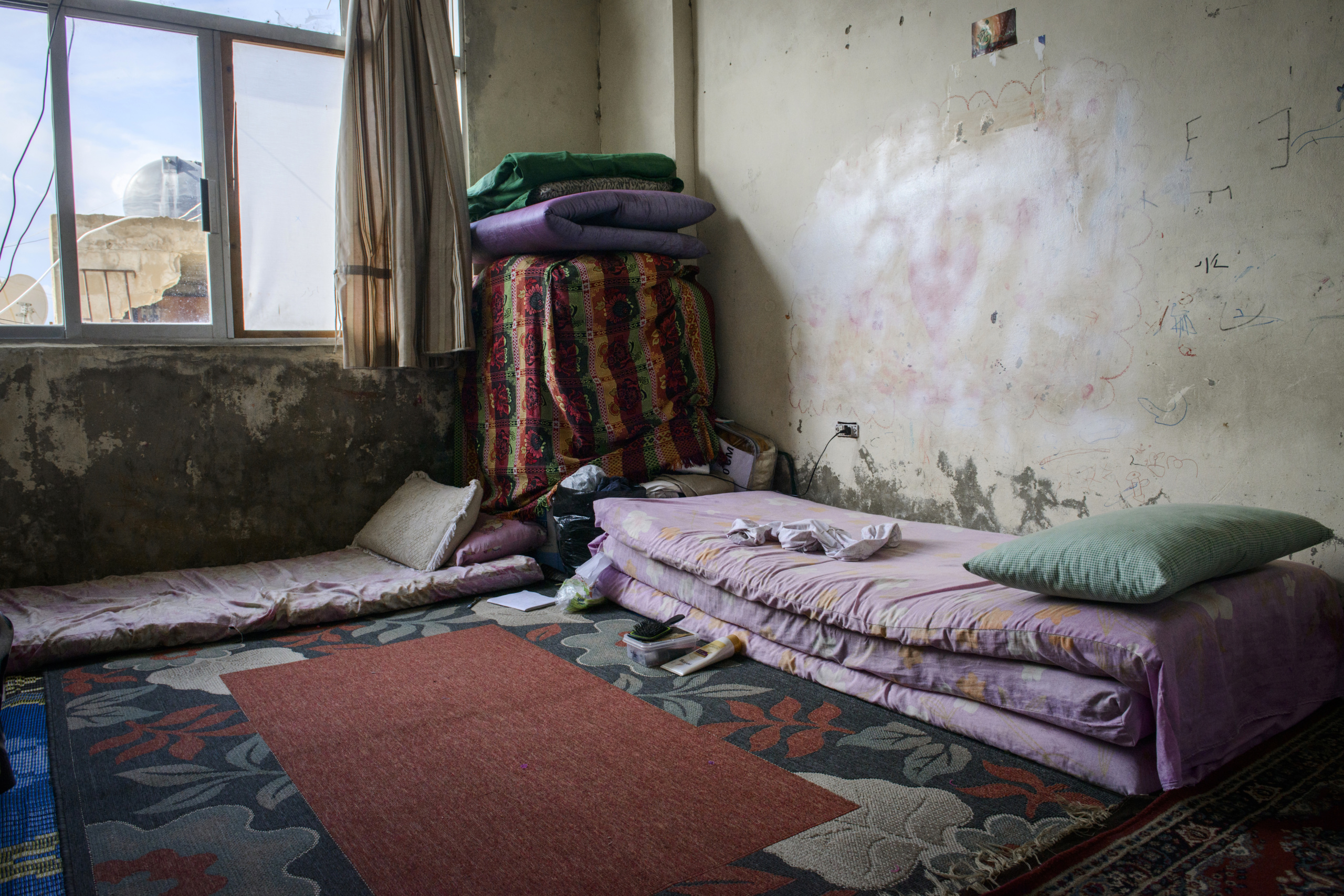 Saida-Lebanon. A room inside an  abandoned construction site occupied by Syrian refugees.This building is located in the center of Saida . The owner gave access electricity and water free of charge to refugees. . The refugees  try to survive through public subsidies and underpaid labor. the Lebanese government will not allow traditional refugee camps in Lebanon, refugees are finding unusual places to live across the country, including unfinished homes, abandoned shopping malls and schools .......