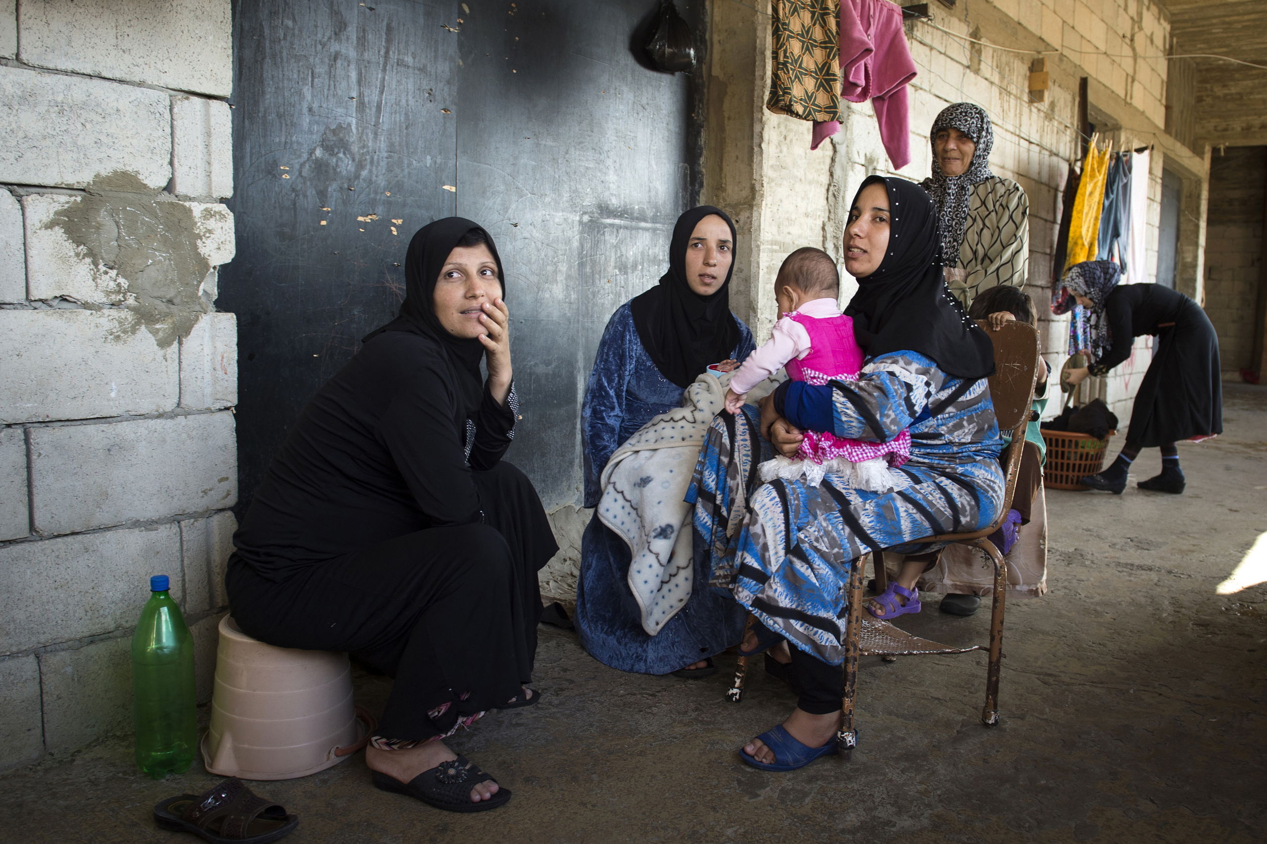 "Saida-Lebanon. Women inside an abandoned construction site occupied by Syrian refugees. This building, referred to as a ""collective shelter"", is owned by the Islamic University and financed by a Kuwaiti association. About 150 families live within it, all from the Syrian Daraa region. The refugees try to survive through public subsidies and underpaid labor. the Lebanese government will not allow traditional refugee camps in Lebanon, refugees are finding unusual places to live across the country, including unfinished homes, abandoned shopping malls and schools ……."