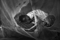 Soroti,UGANDA. A child inside is bush house. Malaria is prevalent in Uganda due to the poor living conditions.